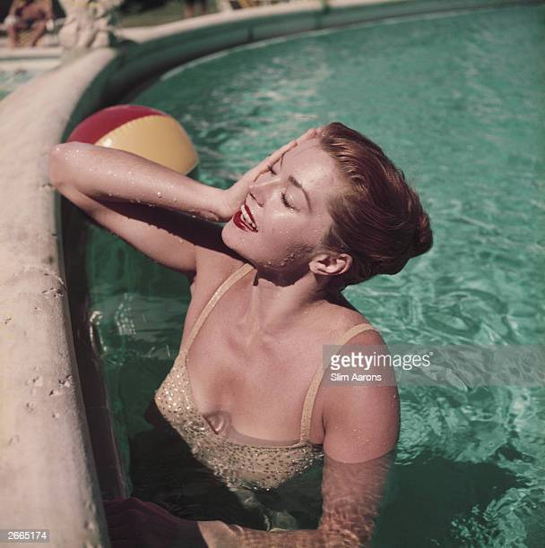 Esther Williams American aquatic actress and former swimming champion relaxing in a Florida swimming pool