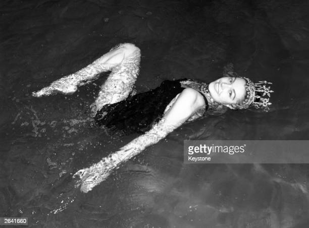 Esther Williams American aquatic actress rehearsing in the water at Wembley Pool for her forthcoming aqua show