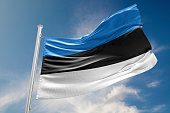 Estonia flag is waving at a beautiful and peaceful sky in day time while sun is shining. 3D Rendering