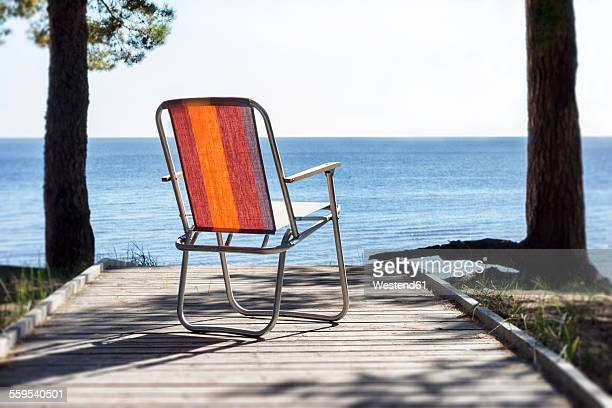 Estonia, Kauksi, beach chair on wooden boardwalk at lake Peipsi