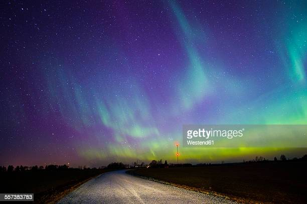 Estonia, Northern lights over empty road