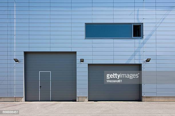 Estonia, Tallinn, facade with window and roller shutters of a modern building