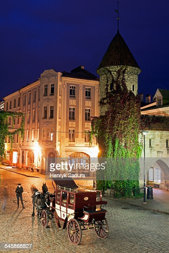 Estonia, Tallinn, Horse cart on street at night