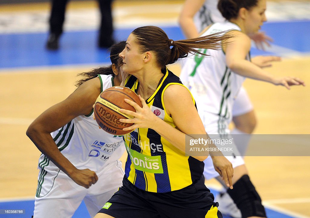Estonian Anastasiya Verameyenka (C) of the Turkish Fenerbahce Istanbul scores against Hungarian Hat-Agro UNI Gyor in Gyor on February 22, 2013 during the Euro League match.