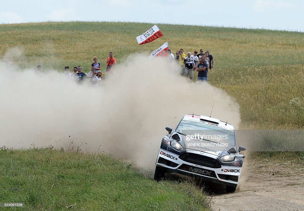 Estonian driver Ott Tanak and his compatriot co-driver Raigo Molder drive their Ford Fiesta RS WRC during the special stage of The Rally of Poland in Stare Juchy, north of Poland on July 1, 2016. / AFP / JANEK