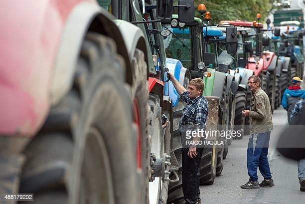 Estonian farmers demonstrate in front of the Parliament building on September 15 2015 in Tallinn demanding that the EU transitional allowances make...