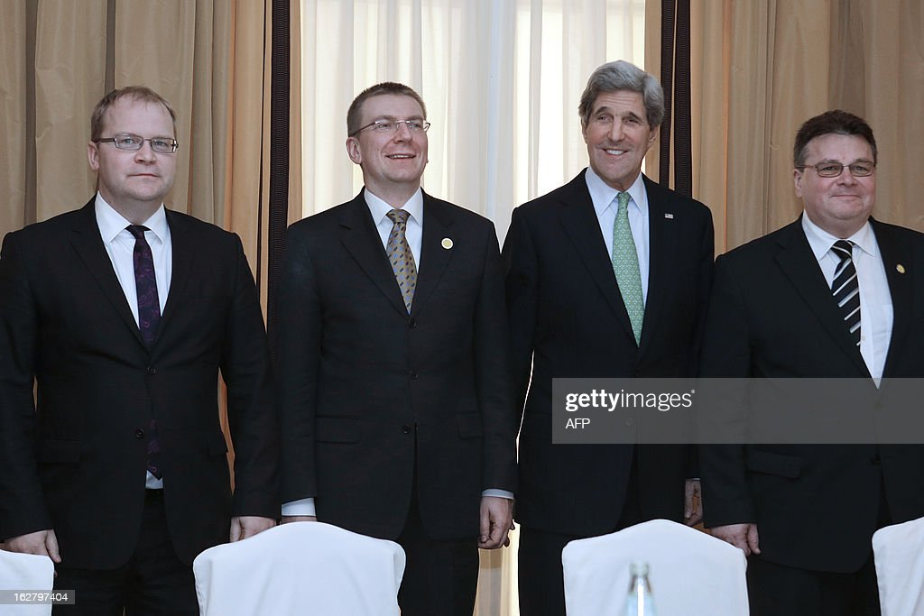 Estonian Foreign Minister Urmas Paet (L), Latvian Foreign Minister Edgars Rinkevics, (2ndL) U.S. Secretary of State John Kerry (2ndR) and Lithuanian Foreign Minister Linas Linkevicius (R) pose before a meeting at the Hotel Excelsior in Rome on February 27, 2013. Rome, where talks will Syria be held, is the fourth leg of Kerry's first official overseas trip, a hectic nine-day dash through Europe and the Middle East.