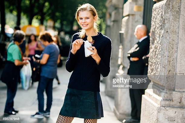 Estonian model Alexandra Elizabeth Ljadov enjoys a gelato between the two Jil Sander shows during the Milan Fashion Week Spring/Summer 16 on...