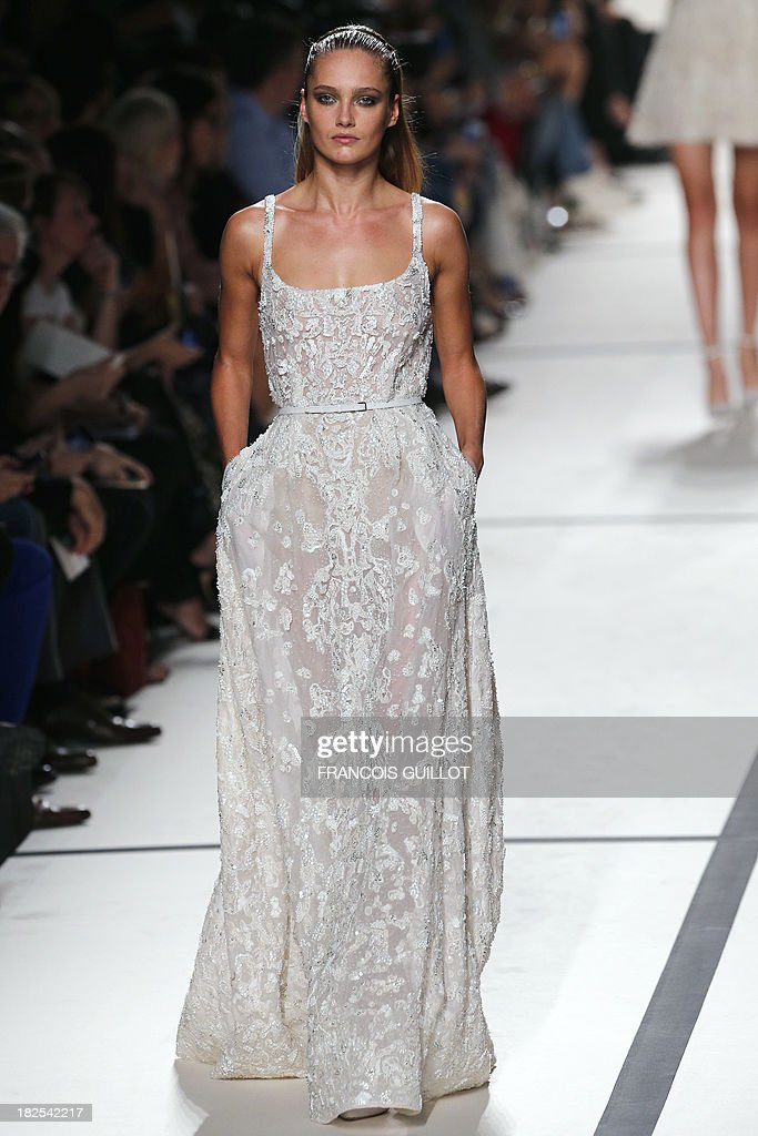 Estonian model Karmen Pedaru presents a creation by Elie Saab during the 2014 Spring/Summer ready-to-wear collection fashion show, on September 30, 2013 in Paris.