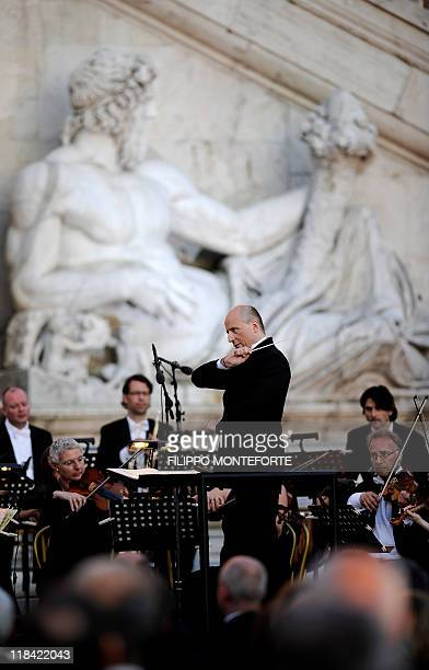 Estonian orchestra director Paavo Jarvi directs Brema's philarmonic orchestra to mark Italy's 150 anniversary of its union as a state at the presence...