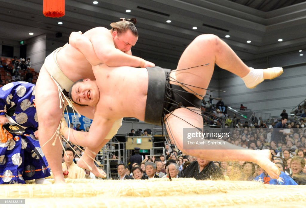 Estonian ozeki Baruto (L), whose real name is Kaido Hoovelson throws Ikioi to win during day one of the Grand Sumo Spring Tournament at Osaka Prefectural Gymnasium on March 10, 2013 in Osaka, Japan.