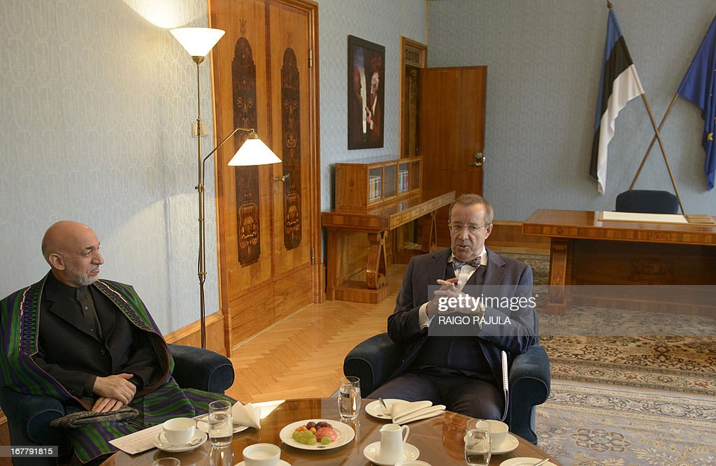Estonian President Toomas Hendrik Ilves (R) and Afghanistan's President Hamid Karzai (L) talk during a meeting in Tallinn, Estonia on April 30, 2013. Karzai arrived on Monday, April 29, 2013 for a two day official visit to the Baltic state.