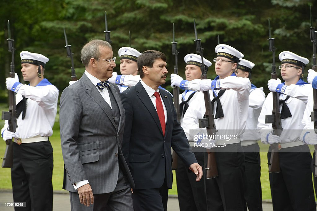 Estonian President Toomas Hendrik Ilves (L) and his Hungarian counterpart Janos Ader review an honor guard during their meeting in Tallinn on June 20, 2013. AFP PHOTO / RAIGO PAJULA ESTONIA OUT