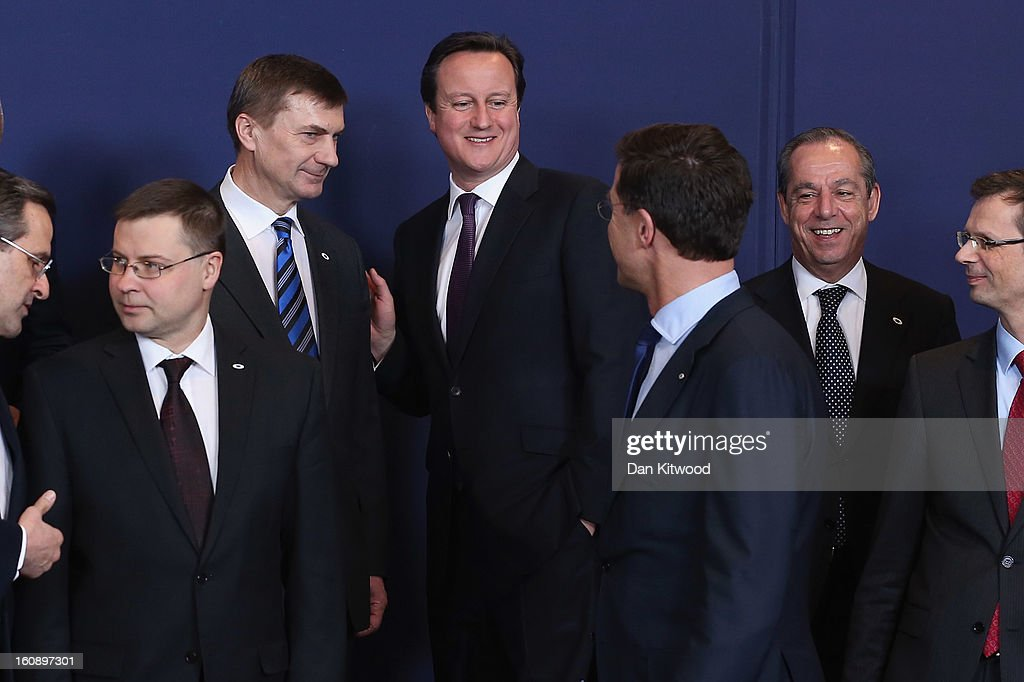 Estonian Prime Minister <a gi-track='captionPersonalityLinkClicked' href=/galleries/search?phrase=Andrus+Ansip&family=editorial&specificpeople=566399 ng-click='$event.stopPropagation()'>Andrus Ansip</a> (2L), British Prime Minister <a gi-track='captionPersonalityLinkClicked' href=/galleries/search?phrase=David+Cameron+-+Pol%C3%ADtico&family=editorial&specificpeople=227076 ng-click='$event.stopPropagation()'>David Cameron</a> (C), Maltese Prime Minister <a gi-track='captionPersonalityLinkClicked' href=/galleries/search?phrase=Lawrence+Gonzi&family=editorial&specificpeople=568017 ng-click='$event.stopPropagation()'>Lawrence Gonzi</a> (2R) and General Secretary of the Council Uwe Corsepius (R) stand for a family photo during the European Council Meeting on February 7, 2013 in Brussels, Belgium. The President of the European Council, Herman Van Rompuy has announced that he will aim to reach an agreement on the EU's 2014-2020 budget during the two-day summit, which takes place on February 7 and 8. Cameron is expected to demand further cuts or a freeze to EU spending to reflect the national austerity measures implemented across Europe, amid stiff opposition from EU funded countries.