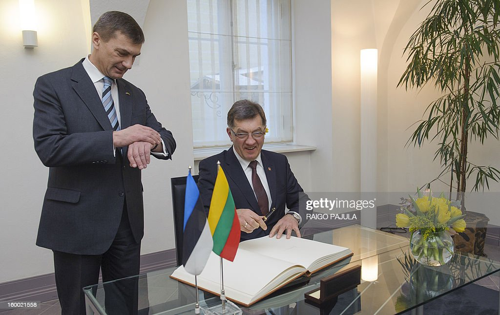 Estonian Prime Minister Andrus Ansip (L) stands next to Lithuanian counterpart Algirdas Butkevicius after he signed a guest book before a joint press conference in Tallinn on January 24, 2013.