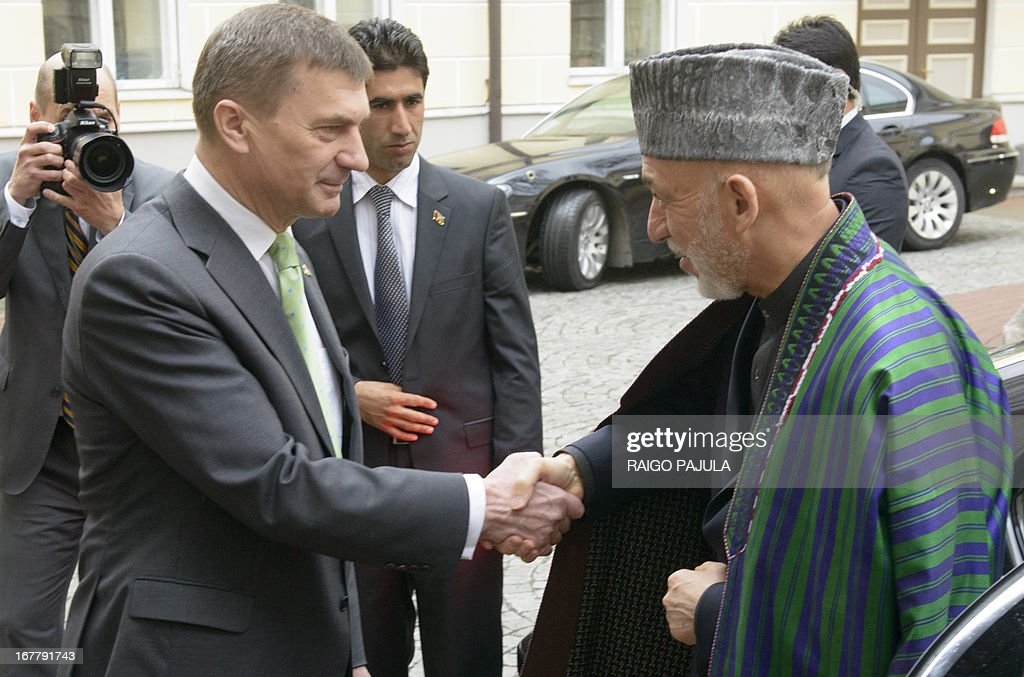 Estonian Prime Minister Andrus Ansip (L) welcomes Afghanistan's President Hamid Karzai for a meeting in Tallinn, Estonia on April 30, 2013. Karzai arrived on Monday, April 29, 2013 for a two day official visit to the Baltic state.