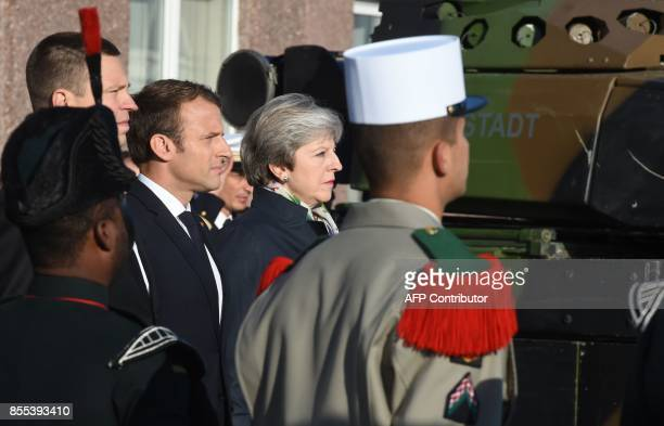Estonian Prime Minister Juri Ratas French President Emmanuel Macron and British Prime Minister Theresa May inspect a military honor guard as they...