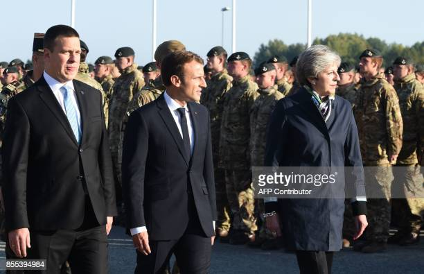 Estonian Prime Minister Juri Ratas French President Emmanuel Macron and British Prime Minister Theresa May inspect troops as they visit an Estonian...