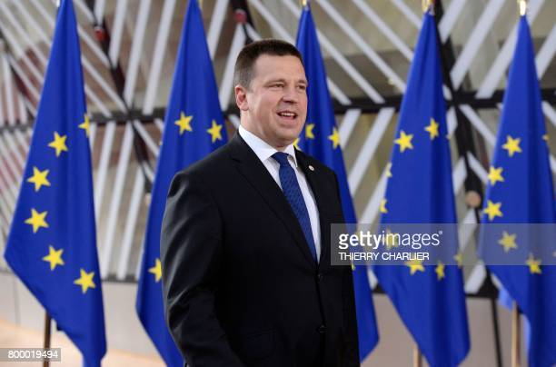Estonian Prime Minister Juri Ratas speaks to the press as he arrives on the second day of a summit of European Union leaders and focusing on...