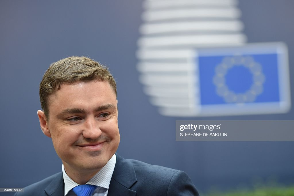 Estonian Prime Minister Taavi Roivas arrives for the second day of an EU - Summit at the EU headquarters in Brussels on June 29, 2016. European Union leaders will on June 29, 2016 assess the damage from Britain's decision to leave the bloc and try to prevent further disintegration, as they meet for the first time without a British representative. / AFP / STEPHANE