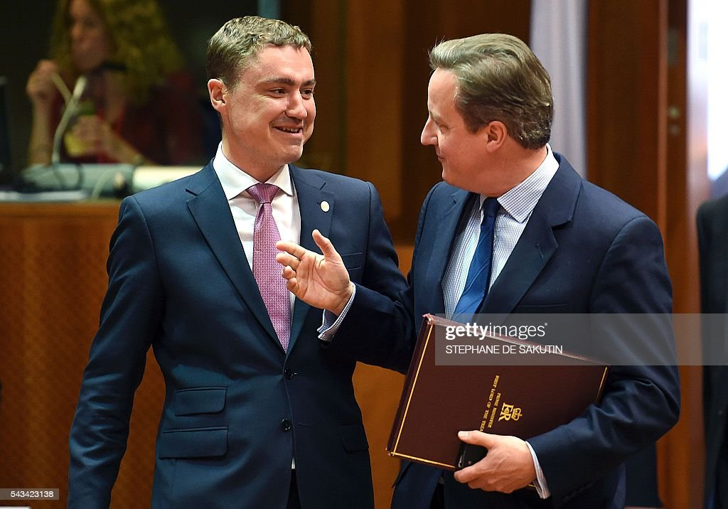 Estonian Prime Minister Taavi Roivas (L) talks with Britain Prime Minister David Cameron (R) during EU - Summit at the EU headquarters in Brussels on June 28, 2016. Prime Minister David Cameron said today he wants the 'closest possible' relations with the EU after Britain voted to leave the bloc, adding the split should be 'as constructive as possible'. As he arrived at a Brussels summit, Cameron, who is to step down within weeks, told reporters that, while Britain was leaving the EU, 'we mustn't be turning our backs on Europe.' SAKUTIN