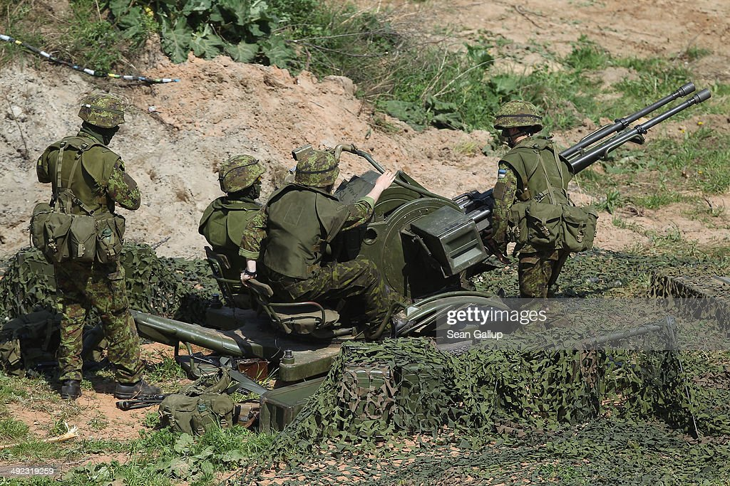 Estonian soldiers man an antiaircraft gun during a simulated aircraft attack during the NATO 'Spring Storm' military exercises on May 19 2014 near...