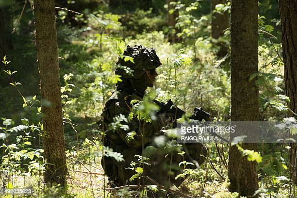 Estonian soldiers take part in an annual military exercise together with several units from other NATO member states on May 18 2014 near Voru close...