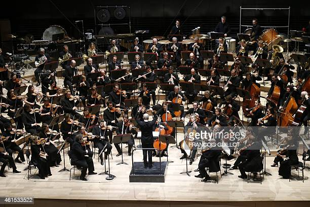 Estonianborn American conductor Paavo Jarvi conducts the Orchestre de Paris during the gala opening of the Paris Philharmonie concert hall on January...