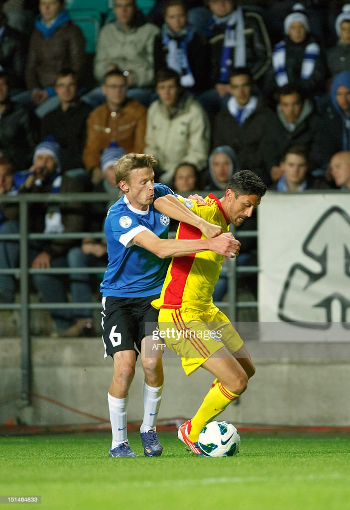 Estonia's Aleksandr Dmitrijev (L) vies for the ball with Romania's Ciprian Marica (R) during their FIFA 2014 World Cup qualifying football match in Tallin on September 7, 2012. Romania won 2-0. AFP PHOTO / Jarek Joepera
