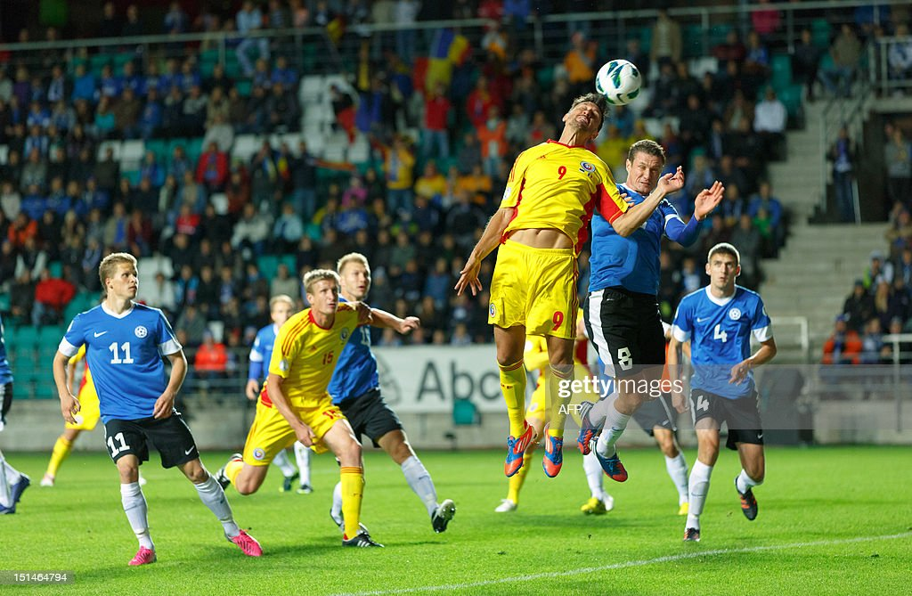 Estonia's Andres Oper (2nd R) vies for the ball with Romania's Ciprian Marica (3rd R) during their FIFA 2014 World Cup qualifying football match in Tallin on September 7, 2012. Romania won 2-0. AFP PHOTO / Jarek Joepera