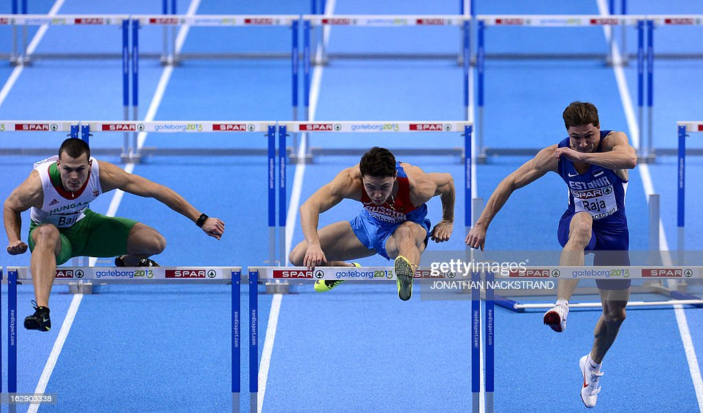 Estonia's Andres Raja (R), Russia's Konstantin Shabanov (C) and Hungary's Balazs Raji compete during the 2nd heat of the 60m Hurdles Men event at the European Indoor Championships in Gothenburg, Sweden, on March 1, 2013.