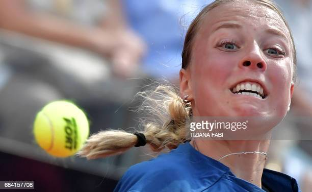 Estonia's Anett Kontaveit hits a return to Angelique Kerber of Germany during the WTA Tennis Open tournament at the Foro Italico on May 17 2017 in...