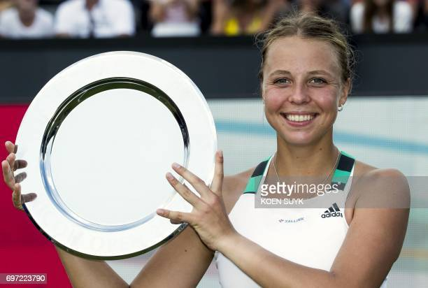 Estonia's Anett Kontaveit poses with the trophy after winning the ladies final tennis match of the Ricoh Open Tennis tournament against Russia's...