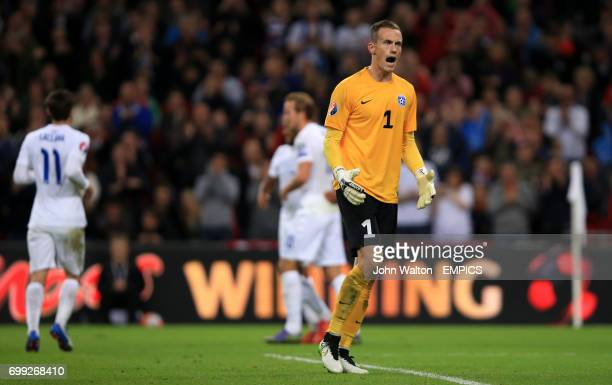 Estonia's goalkeeper Mihkel Aksalu screams in frustration after conceding the opening goal of the game scored by England's Theo Walcott