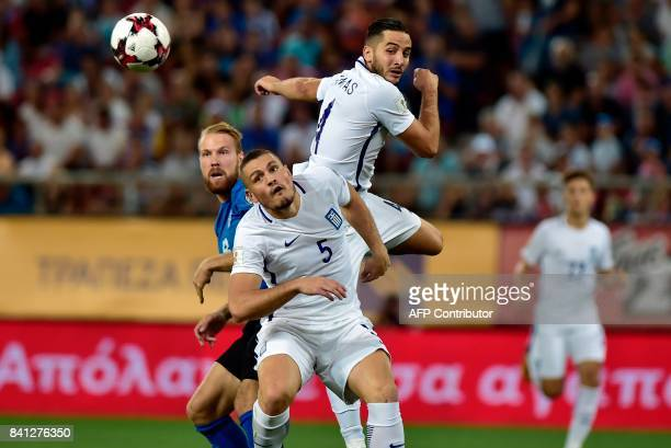 Estonia's Henri Anier vies with Greece's Kostas Manolas during the 2018 FIFA World Cup qualifying football match between Greece and Estonia on August...