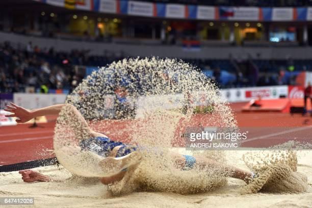 TOPSHOT Estonia's Henrik Kutberg competes in the men's long jump qualifications at the 2017 European Athletics Indoor Championships in Belgrade on...