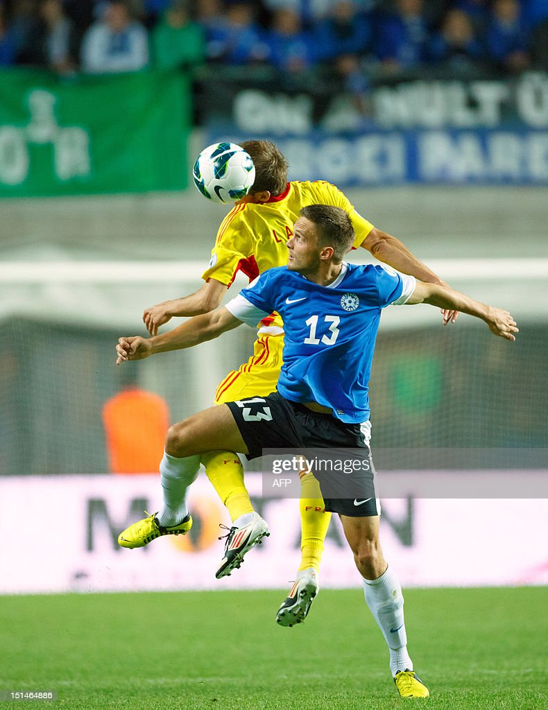 Estonia's Martin Vunk (R) vies for the ball with Romania's Costin Lazar (L) during their FIFA 2014 World Cup qualifying football match in Tallin on September 7, 2012. Romania won 2-0. AFP PHOTO / Jarek Joepera