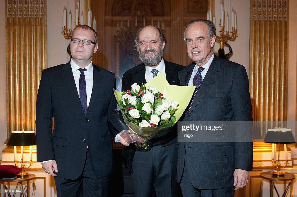 Estonia's Minister of Foreign Affairs Urmas Paet, Classical Composer Arvo Part and French's Minister of Culture and Communication Frederic Mitterrand pose after Classical Composer Arvo Part being awarded 'Chevalier dans l'ordre de la Légion d'Honneur' at Ministere de la Culture on November 2, 2011 in Paris, France.