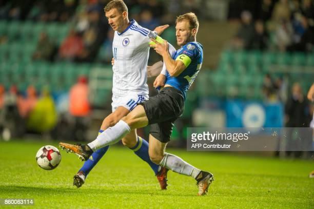 Estonia's Ragnar Klavan and Bosnia's Edin Dzeko vie for the ball during the FIFA World Cup 2018 Europe qualification football match between Estonia...