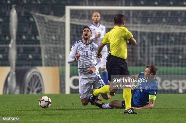 Estonia's Ragnar Klavan and Bosnia's Haris Medunjanin vie for the ball during the FIFA World Cup 2018 qualification football match between Estonia...