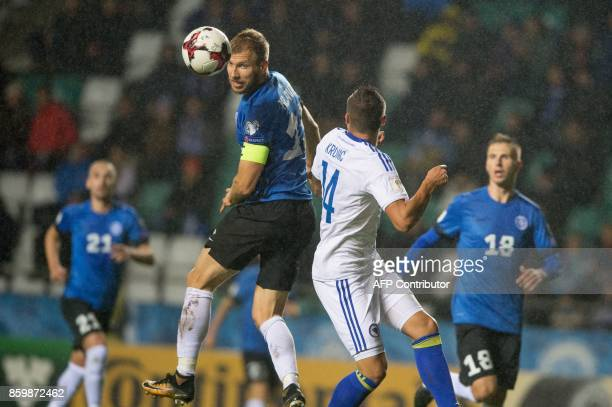 Estonia's Ragnar Klavan and Bosnia's Rade Krunic vie for the ball during the FIFA World Cup 2018 qualification football match between Estonia and...
