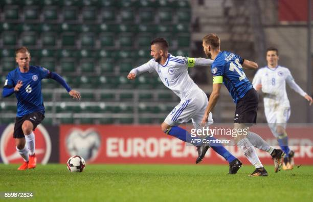 Estonia's Ragnar Klavan and Bosnia's Vedad Ibisevic vie for the ball during the FIFA World Cup 2018 qualification football match between Estonia and...
