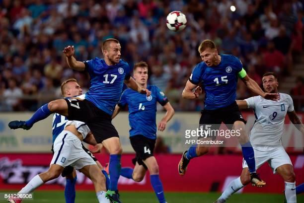 Estonia's Ragnar Klavan and Enar Jaager vies with Greece's Apostolos Vellios and Kostas Manolas during the 2018 FIFA World Cup qualifying football...