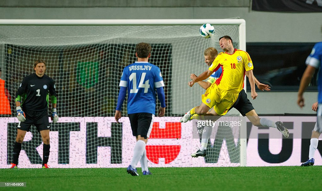 Estonia's Ragnar Klavan (2nd R) vies for the ball with Romania's Marius Niculae (R) during their FIFA 2014 World Cup qualifying football match in Tallin on September 7, 2012. Romania won 2-0. AFP PHOTO / Jarek Joepera
