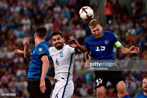 Estonia's Ragnar Klavan vies with Greece's Alexandros Tziolis during the 2018 FIFA World Cup qualifying football match between Greece and Estonia at...