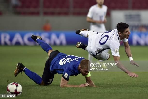 Estonia's Ragnar Klavan vies with Greece's Petros Mantalos during the 2018 FIFA World Cup qualifying football match between Greece and Estonia at the...