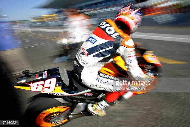 Nicky Hayden of the US leaves the paddock on his bike during the free practice 2 for the Moto GP World Championship in Estoril 13 October 2006 AFP...