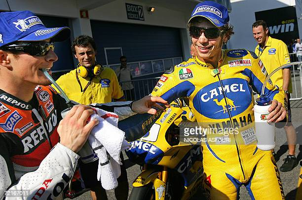 Valentino Rossi of Italy and Nicky Hayden of the US are seen in the paddock after the qualifying practice for the Moto GP World Championship in...