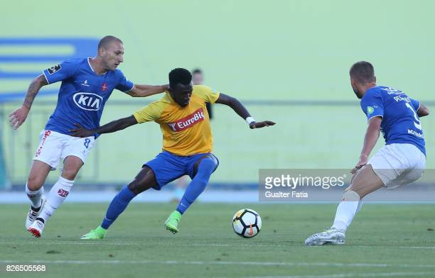Estoril Praia forward Allano Lima from Brazil with CF Os Belenenses midfielder Andre Sousa from Portugal in action during the PreSeason Friendly...