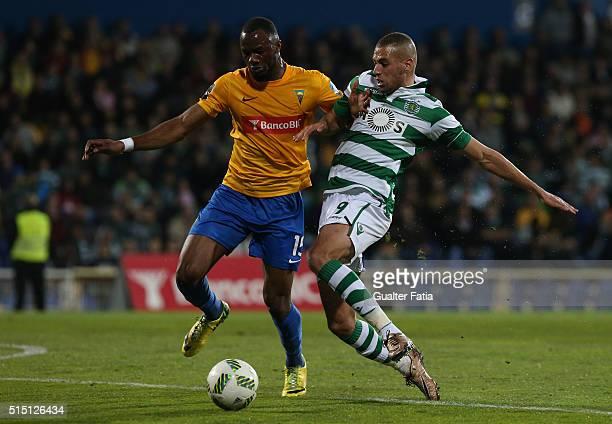 Estoril Praia's defender Oumar Diakhite tackles Sporting CP's forward Islam Slimani from Algeria during the Primeira Liga match between GD Estoril...